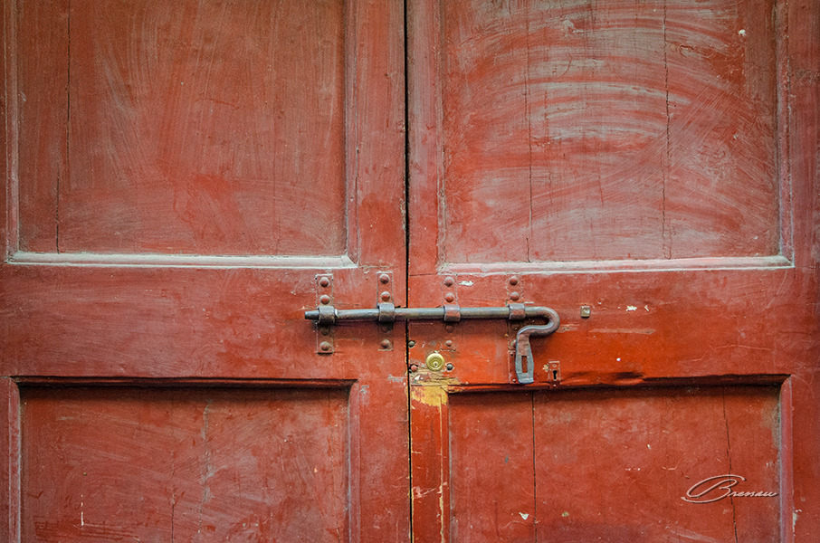 The Battered Door With Two KeyHoles