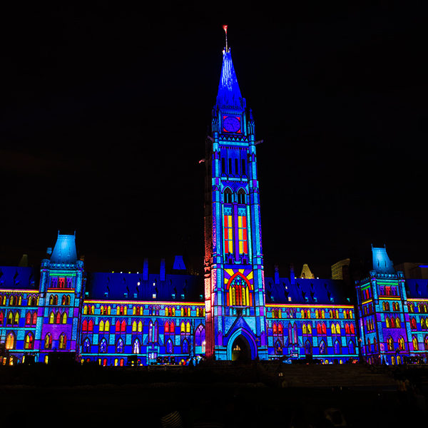 Parliament Building Covered With a Light Show.